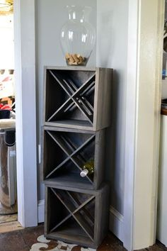 Love this wine rack idea, complete with pretty storage for the corks on top!