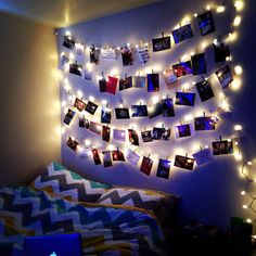 Bedroom decoration idea with pictures, lights and clothespins.