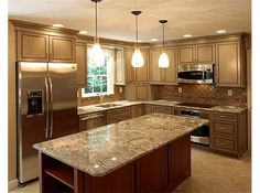 Lavish kitchen design with marble countertops and pendant lighting