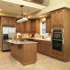 Cabinets: Ginger Maple with a Mocha Glaze, Standard Overlay using Crown Raised Panel door style