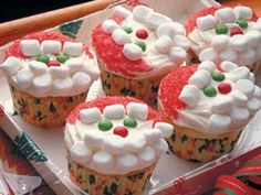 Cute santa's ...    Ingredients    24 paper baking cups  1 (18.5-ounce) package white cake mix, batter prepared according to package directions  1 1/2 cups mini holiday candy-coated chocolate candies, divided  1 (16-ounce) container vanilla frosting  Red sugar crystals for garnish  Mini marshmallows  Instructions       Preheat oven to 350 degrees F