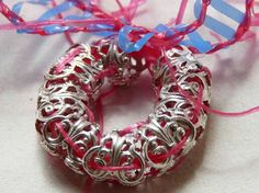 Necklace by Ivča Vostrovska. Recycled from old vintage bracelet and potatosack.