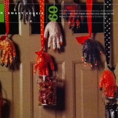 No more doorway cobwebs!!  Stuff vinyl gloves ($5 on restockit.com) with jellybeans and candy corn.  Place contrasting color in the fingertips.  Knot the wrist, tie to ribbon, dangle on your front door.  (Cookie magazine)