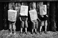 let the kids draw there own crazy, goofy, faces then take a photo of them all wearing there paper bag masks :) makes a pretty cute photo wouldn't you say