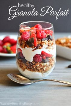 Granola Parfait made with a healthier granola (made using coconut oil!) The parfait is layered with granola, dark chocolate, Greek yogurt and berries – delicious!