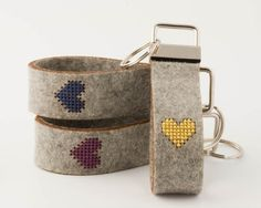 Stitch your own keychain with this DIY cross stitch kit. The felt is durable yet soft, and the key fob makes a great gift for teachers, grandparents, or crafty friends.  Each kit comes with all the materials you need to make one key fob. The key fob is made from thick 100% wool felt, and the heart pattern is precision cut into the felt making it a breeze to cross stitch. When you're done stitching, simply attach the keychain hardware using a pair of sturdy pliers (not included).