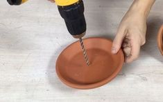 s 3 ideas to use terracotta pots you definitely haven t seen before, Step 9 Drill a hole in a terracotta saucer Funky Junk, Cute Diy, Garage Sale Finds, Tomato Cages, Terracotta Pots, Clay Pots, Dollar Stores, Decoration, Flower Pots
