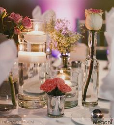 Delicate floral trio with floating candle. Wedding flowers, wedding centerpieces, silver and glass vases, pink flowers. Floating Candles, Wedding Centerpieces, Pink Flowers, Glass Vase, Wedding Flowers, Floral Design, Delicate, Wedding Inspiration, Table Decorations
