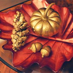 Use items from nature and gold spray paint to decorate your home this autumn.