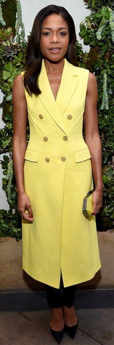 Who made Naomie Harris' yellow sleeveless coat?