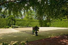 tennis court w/natural fence Bocce Ball Court, Nantucket Home, Lawn Tennis, Landscape Services, Outdoor Fun, Sport Outdoor, Country Estate, Hedges, Landscape Design