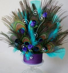 Peacock cake topper// Skip the bright teal and use a purple-blue instead