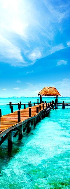 3.Tropical Paradise Jetty on Isla Mujeres, Mexico Isla Mujeres is an island in the Caribbean Sea, about 13 kilometres (8.1 mi) off the Yucatán Peninsula coast. The island is some 7 kilometres (4.3 mi) long and 650 metres (2,130 ft) wide. To the east is the Caribbean Sea with a strong surf and rocky coast, …