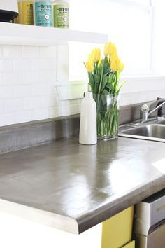 From abeautifulmess.com, how to transform dated Formica into stunning cement countertops.