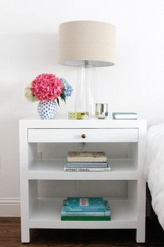 Small Nightstand Designs That Fit In Tiny Bedrooms. Lamp, scriptures, easy access to outlets.