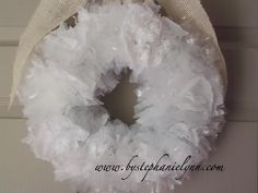 Repurposed plastic shopping bags..can also use Dollar tree bath scrubbers in white...unravel and fluff and push into wreath form.