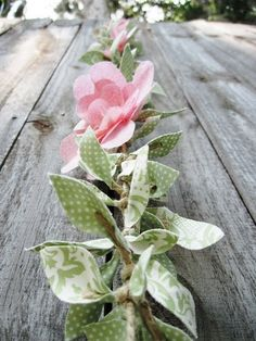 Fabric floral garland...  I want to try this on a white wire clear light string.