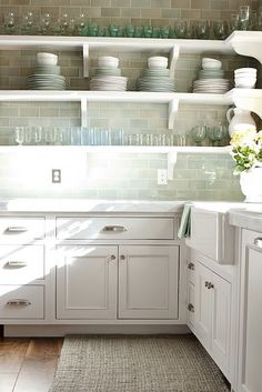 light and bright kitchen with soft sea blue/green subway tile backsplash