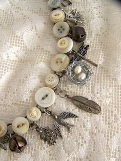 Handmade Button Charm Bracelet Vintage Button Bracelet by QueenBe, $36.50 - I have always thought of making something like this.