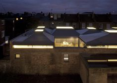 Vaulted House by vPPR is a London residence topped by six protruding skylights.