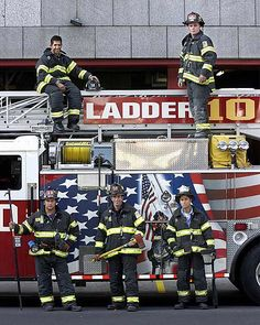 Ladder 10 firefighters pose next to their aerial truck built by Seagrave Fire Apparatus in Clintonville, WI and painted with a special mural to honor New York firefighters following the 9/11 attacks.