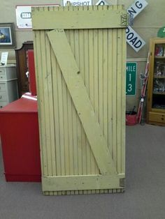 $85 - This is a vintage mustard yellow gate is made from beadboard with one original hinge still existing. Great for D.I.Y. projects. Approximately 70 inches tall 32 inches wide. ***** In Booth E5 at Main Street Antique Mall 7260 E Main St (east of Power RD on MAIN STREET) Mesa Az 85207 **** Open 7 days a week 10:00AM-5:30PM **** Call for more information 480 924 1122 **** We Accept cash, debit, VISA, Mastercard, Discover or American Express