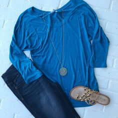 9371ad368be Basic Tee, super soft slinky material with ruched sides and dolman sleeves.