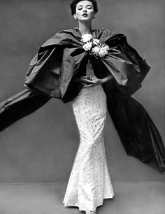 1951 Dorian Leigh in beaded and embroidered sheath gown covered by a red taffeta stole tied in a vast bow in front by Balenciaga