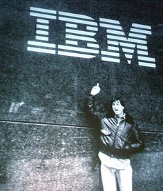 Fuck you IBM - A photo captured nearly 30 years ago and brought to light this week shows a shaggy-haired Steve Jobs, clad in blue jeans and a leather jacket, expressing his affection for then rival IBM while walking the streets of New York City in the lead up to the launch of the first Mac.