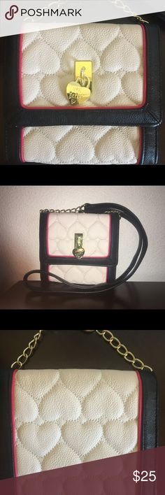 NWOT BETSEY JOHNSON purse BRAND NEW WITHOUT TAGS BETSEY JOHNSON shoulder strap or cross body bag.  It is cream colored with heart shaped stitching and black all around the edges with a tad bit of pink the Betsey logo locket is gold and part of the purse strap is also gold chains. BETSEY JOHNSON Bags Crossbody Bags