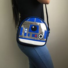 """Super cool R2D2 Crossbody bag by Loungefly X Star Wars. Comes in faux leather embossed applique details and adjustable shoulder strap. Measures W: 8"""" X H: 7.5221"""" X D: 1.5"""""""