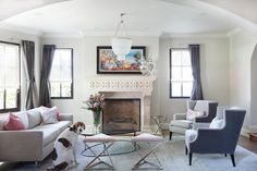 See 40+ living rooms created by interior designers. Whether you want bright colors or clean neutrals, traditional furnishings or modern pieces, a family space or a sleek place to entertain, these  living rooms are sure to inspire.