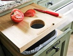 Get this super useful cutting board drawer. Just drill a circular hole in the board and put a waste container underneath.
