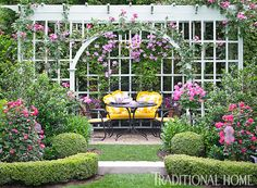 A pergola covered in climbing roses and clematis shades an inviting seating area. Porches, Bluestone Patio, Garden Shrubs, Covered Pergola, Climbing Roses, Garden Structures, Clematis, Dream Garden, Traditional House