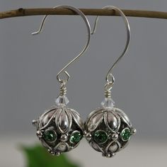 Green Swarovski Crystal Drop Earrings br br Dazzling silver beads inset with sparkling green Swarovski crystals dangle from these darling curved hook wires Measuring mm these are a great addition Swarovski Crystal Earrings, Crystal Drop, Silver Beads, Different Colors, Jewelry Box, Dangles, Sparkle, Drop Earrings, My Style