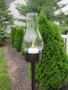 Head to the thrift store and pick up mix match glass globes.create outdoor hurricane lanterns with tuna and other types of cans that can hold candles. I really like this idea and the visuals are super.
