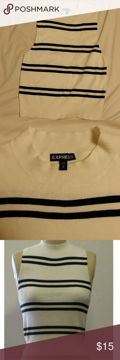 NWOT. EXPRESS. Knit sleeveless top. Mock neck NWOT. EXPRESS. Knit sleeveless top. White with black stripes. Mock neck. Express Tops Tank Tops