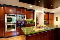 dark cabinets with green counter top. Just wanted you to see how the dark and green looks together, too.