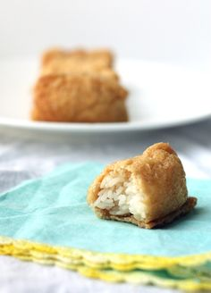 Japanese food - Inarizushi -: rice pocket wrapped with fried tofu sheets. My childhood favorite! Recipe is  http://japaneats.tv/2010/02/07/inarizushi/