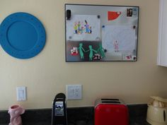 Magnetic bulletin board on a blank wall in the kitchen is the perfect place to rotate out my daughter's artwork