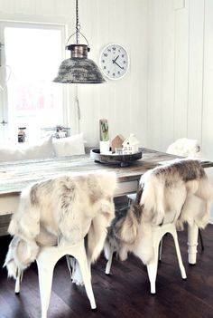 faux fur thrown over chairs. yes.