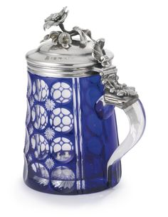 A RUSSIAN SILVER-MOUNTED CASED GLASS TANKARD, ST. PETERSBURG, ABOUT 1840 of blue and colorless cased glass cut with a pattern of circles and stars, Imperial Glass Manufactory, mounted with a hinged lid with a chased blossom, Johann Berghard Hertz, active 1834-1855