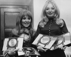 1969 - Lulu and Mary Hopkin with their awards at the Disc and Music Echo Valentine's Day Award Ball in 1969. Lulu picked up awards for being top British Female Singer, Miss Valentine 69' and Top TV Artist.