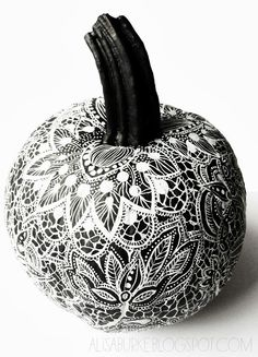 Alisa Burke: lace inspired pumpkins.  In other words, a zentangled pumpkin!  Spray paint the pumpkin black and draw with a white paint marker.