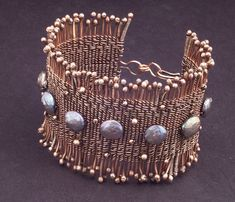Woven cuff bracelet of twined copper wire and peacock coin pearls. Measures wide by (Mary Tucker) WiredElements on Etsy and Deviant Art Copper Jewelry, Copper Wire, Wire Jewelry, Jewelry Crafts, Beaded Jewelry, Copper Cuff, Jewellery, Wire Earrings, Pendant Jewelry