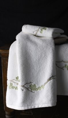 Cherry Blossom: As with all of our botanical designs, Cherry Blossom towels can appear either realistic or highly stylized, the effect you wish to achieve determined by the choice of embroidery thread colors.