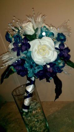My DIY Bridal Bouquet...i love it :  wedding blue bold bouquet ceremony diy feather flowers ivory jewel tones navy peacock purple teal - Beautiful!!