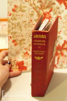 Turn a book into a binder. You could do this with a Christmas book and put your favorite photo's or Christmas cards in it!