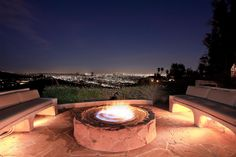follow a stone walkway to admire the lights of the city around a roaring fire pit