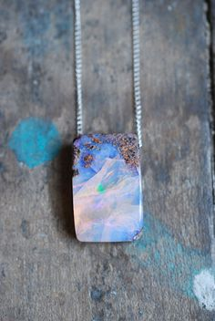 Raw Boulder Opal Pendant I love opals but the rawness makes it even better.